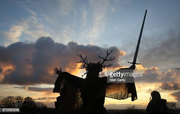 A man representing the Winter King holds a sword as he takes part in a sunset ceremony as they celebrate Samhain at the Glastonbury Dragons Samhain...