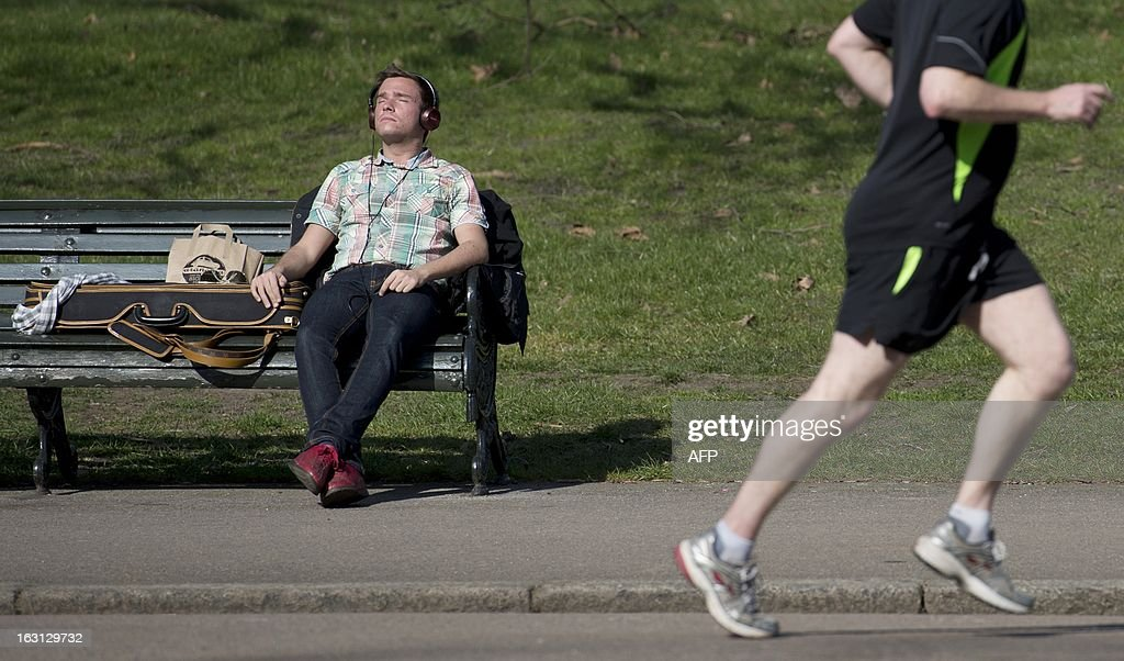 A man rest on a bench in Kensington Gardens during sunny weather in London on March 5, 2013. Areas of Southern England experienced the mildest day of the year so far, with temperatures hovering around 15 degrees celcius.
