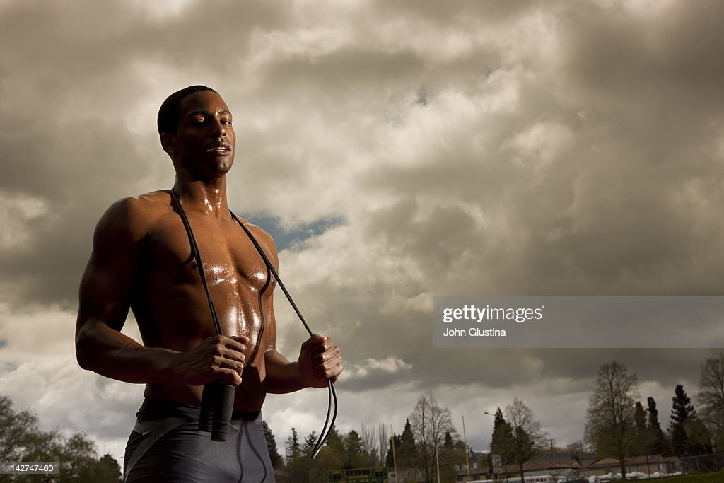 Man resting after jumping rope on track : Stock Photo