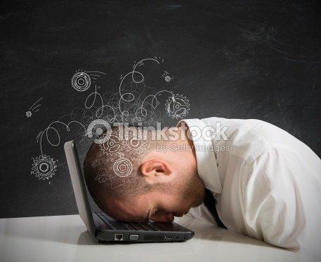 Man resting head on laptop : Stock Photo