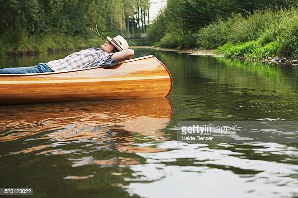 Man Resting in a Canoe
