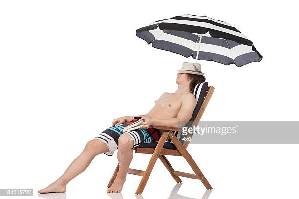 Man resting in a deck chair