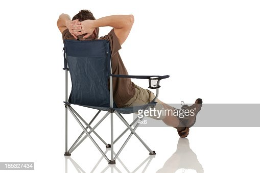 Man resting on a folding chair