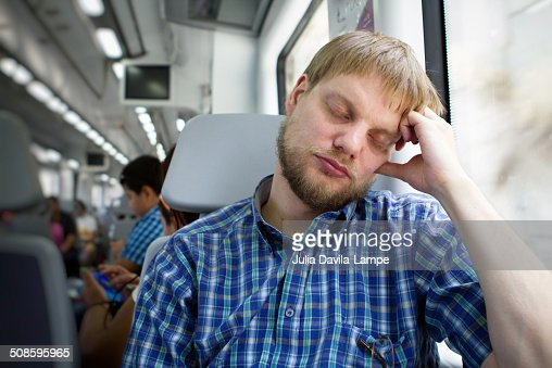 Man resting on a train : Stock Photo