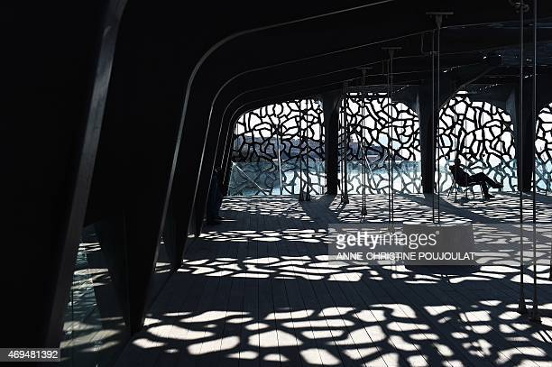A man rests at the Museum of European and Mediterranean Civilisations on April 12 2015 in Marseille southern France AFP PHOTO / ANNECHRISTINE...