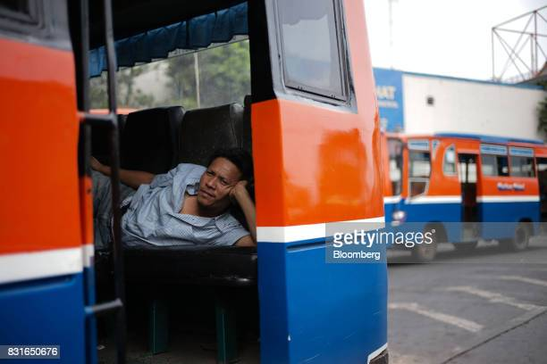 A man rests inside a bus at the Blok M bus terminal in Jakarta Indonesia on Sunday Aug 13 2017 President Joko Widodo is seeking hundreds of billions...