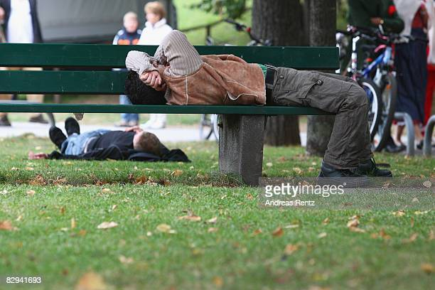 A man rests on a bench during the Oktoberfest beer festival on September 21 2008 in Munich Germany
