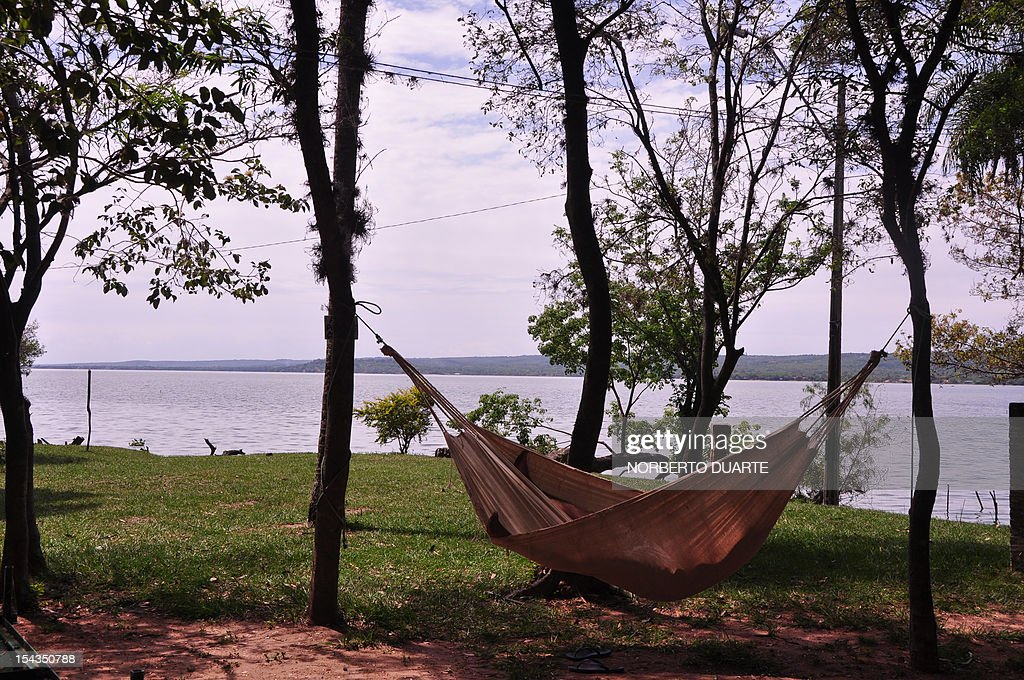 A man rests on a hammock on the banks of the Ypacarai Lake, declared not suitable for bathing, in Ypacarai, Paraguay on October 18, 2012. Paraguay's Health Minister Antonio Corbo said that water samples from the lake analized in Sao Paulo, Brazil with the backing of the Pan American Health Organization determined that the bacteria found in the lake's waterweed present a high level of neurologic and liver toxicity.