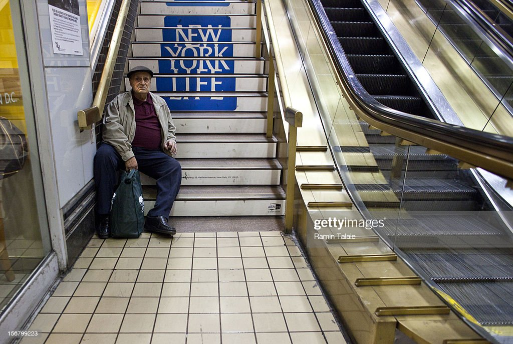 A man rests on stairs at the New York Port Authority bus terminal in Manhattan on November 21, 2012 in New York City. The Port Authority of New York and New Jersey is expecting to handle a high number of travelers at its hubs, bridges, and tunnels ahead of the Thanksgiving holiday.