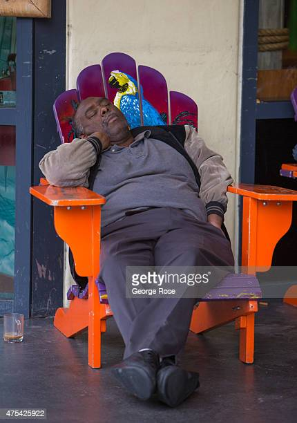 A man rests on the Las Vegas Strip in front of the Flamingo Las Vegas on May 19 2015 in Las Vegas Nevada Tourism in America's 'Sin City' has within...
