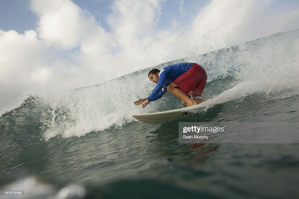 A man ridding a barrel wave in Nicaragua : Stock Photo