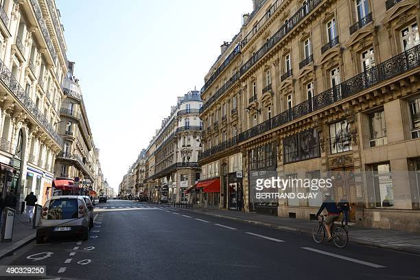 A man rides a bicycle on Reaumur Street during the 'CarFree Day' event in Paris on September 27 2015 as part of the French capital's leadup to...