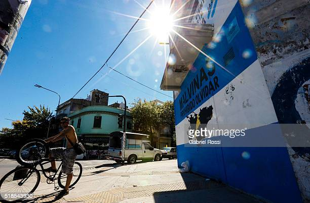 A man rides a bicycle past a Malvinas Islands mural on March 31 2016 in Buenos Aires Argentina On April 02 1982 Leopoldo Fotunato Galtieri de facto...