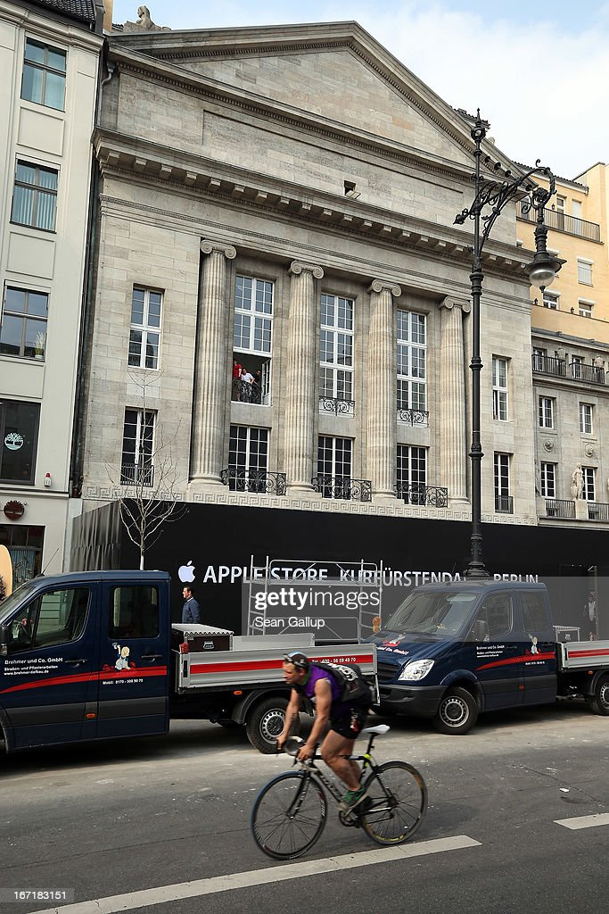 A man rides a bicycle past the construction site of the new Apple Store on Kurfuerstendamm avenue on April 22, 2013 in Berlin, Germany. The store is due to open in May and will the be the first Apple Store to open in the German capital.