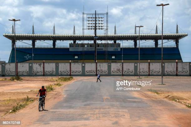 A man rides a bike on October 11 2017 in front of the Milton Correa stadium commonly known as Zerao which was built on the equator line in Macapa...