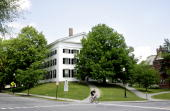 A man rides a bike on the campus of Dartmouth College the smallest school in the Ivy League in Hanover New Hampshire US on Tuesday June 2 2009...