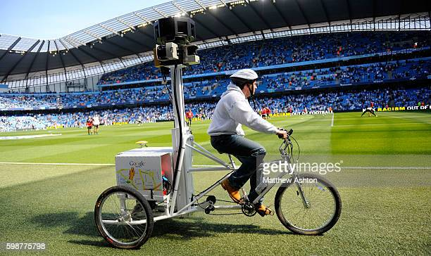 A man rides a Google Trike a tricycle around the City of Manchester Stadium the home of Manchester City filming and creating digital images for...