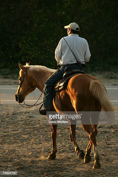 A man rides a horse along the San Gabriel River where the mosquitoes that can carry West Nile Virus are believed to have bred in previous seasons on...