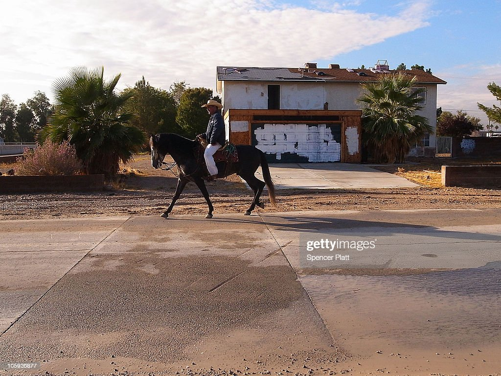 A man rides a horse by an abandoned home on October 21, 2010 in Las Vegas, Nevada. Nevada once had among the lowest unemployment rates in the United States at 3.8 percent but has since fallen on difficult times. Las Vegas, the gaming capital of America, has been especially hard hit with unemployment currently at 14.7 percent and the highest foreclosure rate in the nation. Among the sparkling hotels and casinos downtown are dozens of dormant construction projects and hotels offering rock-bottom rates. As the rest of the country slowly begins to see some economic progress, Las Vegas is still in the midst of the economic downturn.