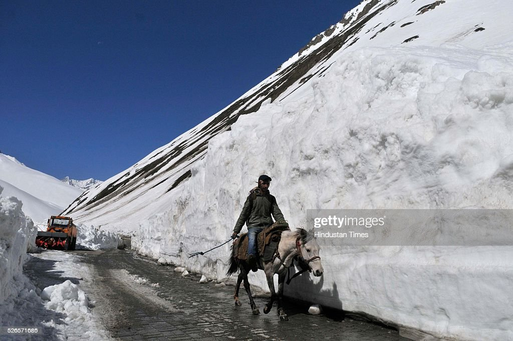 A man rides a horse through a snow bound Zojila pass, 108 kilometers (67 miles) east of Srinagar, on April 30, 2016 in Srinagar, India. The Srinagar-Leh road link was thrown open for vehicular traffic after around five months. India's Border Roads Organisation (BRO) which maintains the road opened it after clearing the snow from Zojila Pass, 3630 meters above sea level. The 434-km Srinagar-Leh National Highway, the only road linking Kashmir with frontier region of Ladakh, has been partially thrown open to vehicular traffic after remaining closed for over six months owing to heavy snowfall during winter. The Pass attracts the heaviest snowfall during the winter and as such it remains closed to traffic for five to six months in a year.