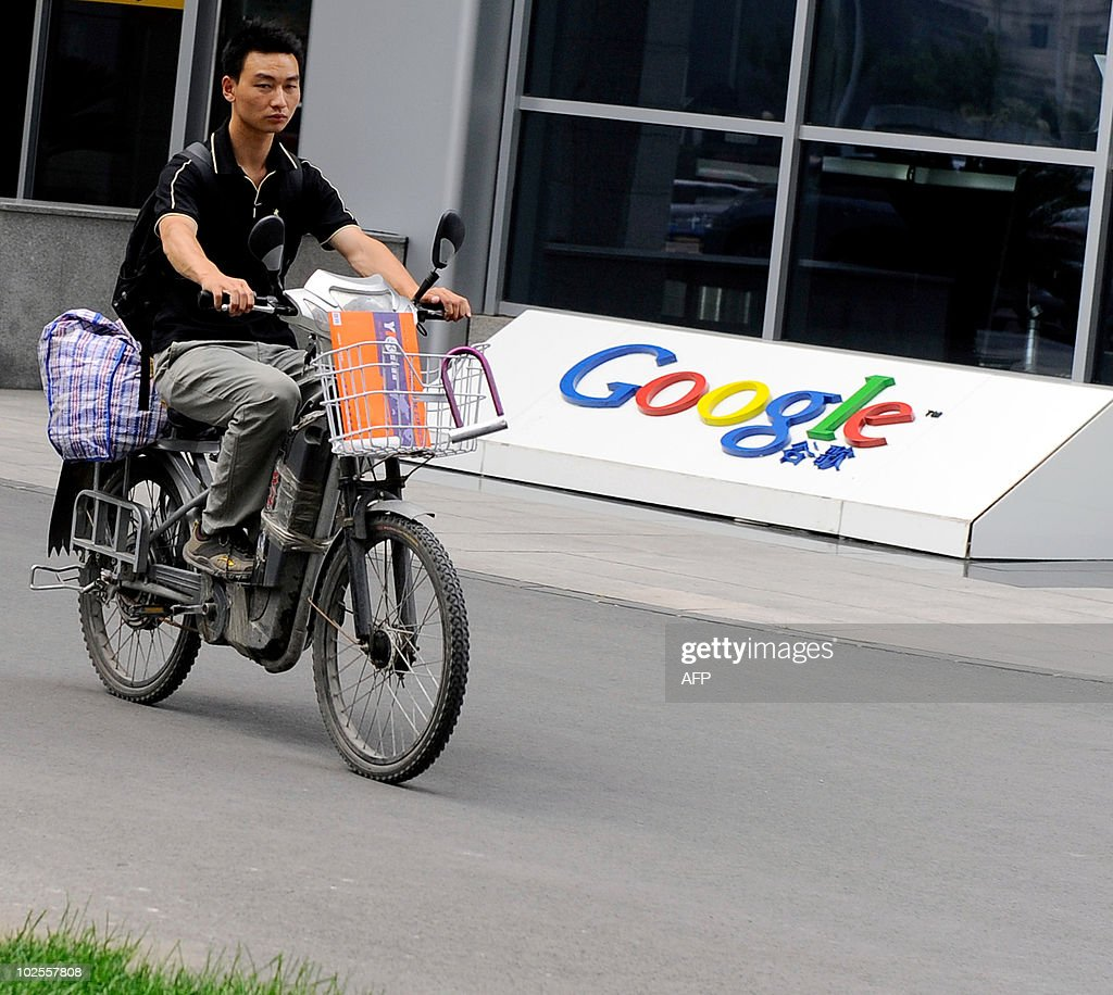 A man rides a motobike past the logo of Google's China headquarters in Beijing on June 30, 2010. Google faced a nervous wait to see if a last-ditch attempt to renew its Chinese business licence would pay off as the Internet giant vies to circumvent official censorship. AFP PHOTO/Franko Lee