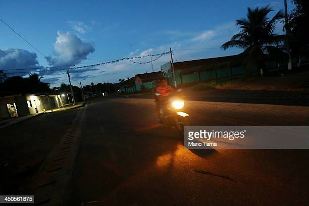 A man rides a motorcycle in a deforested section along the Interoceanic Highway in the Amazon lowlands on November 16 2013 in Planchon Madre de Dios...