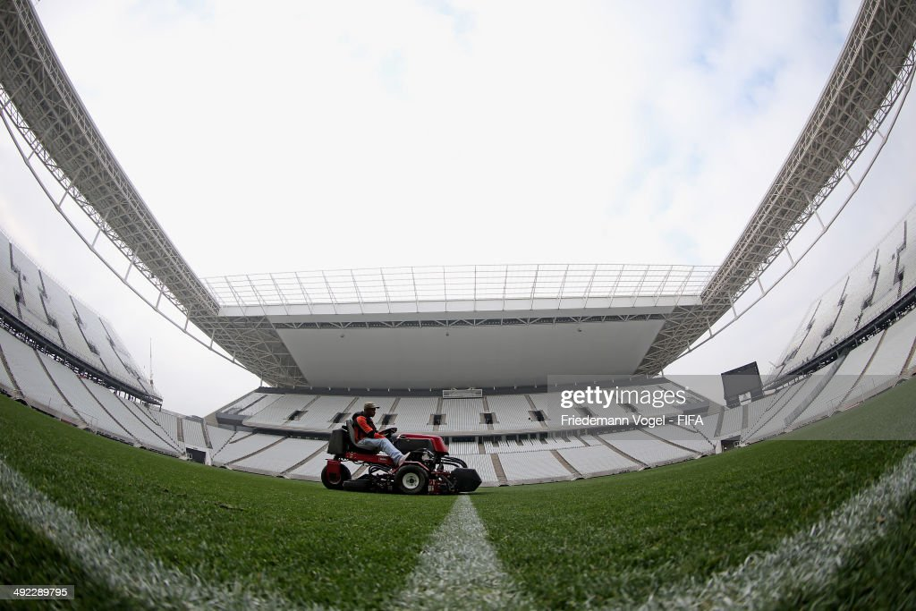 A man rides a mower during the tour of the brand new Arena Sao Paulo during the 2014 FIFA World Cup Host City Tour on May 19, 2014 in Sao Paulo, Brazil.