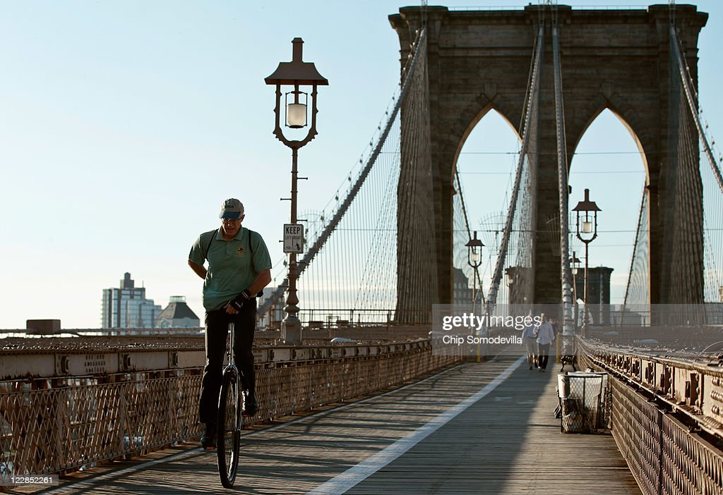 A man rides a unicycle across the Brooklyn Bridge into Manhattan August 29, 2011 in New York City. One day after Hurricane Irene hit New York and New England, the mass transit system, including subways and buses, began moving again in a limited capacity in time for Monday's rush hour.