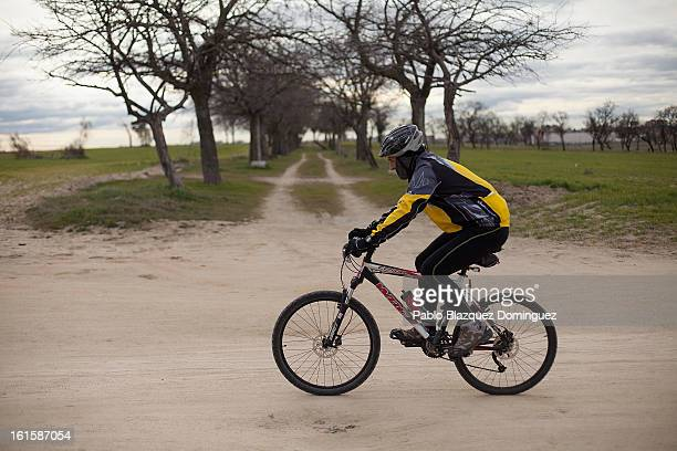 A man rides his bicycle alongside fields used to grow cereal crops and located on the site of the proposed 'Eurovegas' complex on February 10 2013 in...