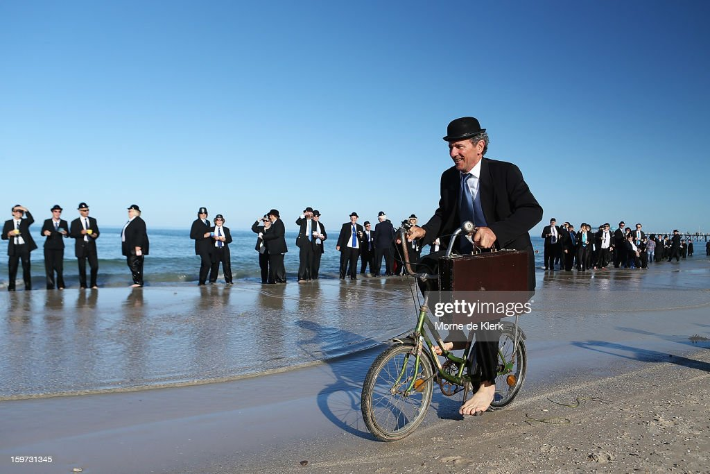 A man rides his bicycle on the beach while taking part in an art installation created by surrealist artist Andrew Baines on January 20, 2013 in Adelaide, Australia.
