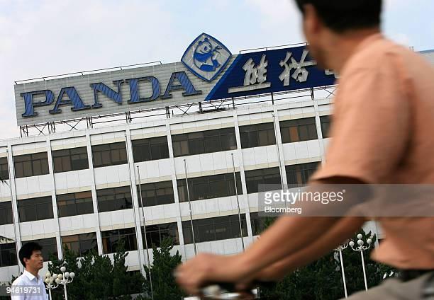 A man rides his bicycle past Nanjing Panda Electronics Co Ltd headquarters in Nanjing Jiangsu province China Sunday August 20 2006 Nanjing Panda...