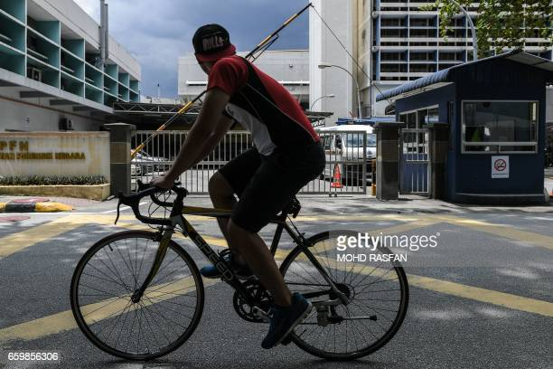 A man rides his bicycle past the forensics wing of the Hospital Kuala Lumpur where the body of Kim JongNam halfbrother of North Korea's leader Kim...