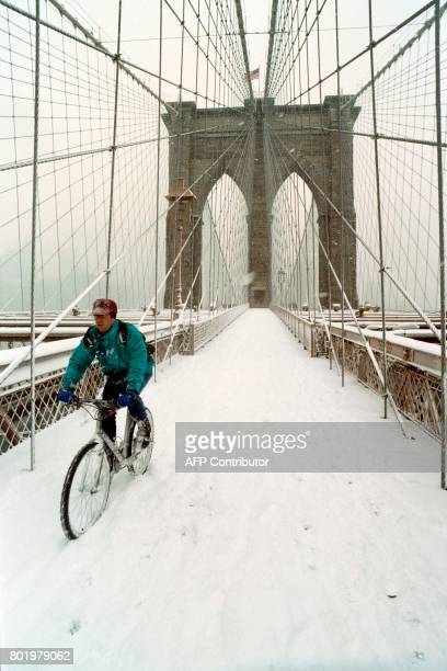 A man rides his bike across the brooklyn Bridge on March 2 1996 as snow coated the city Storm set an alltime record of 663 inches for the winter...