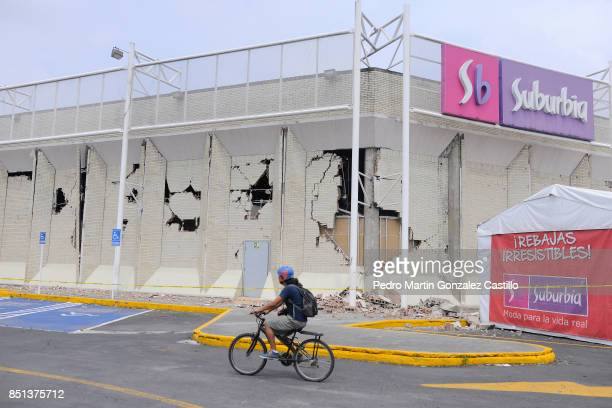 A man rides his bike in front of a damaged market two days after the magnitude 71 earthquake jolted central Mexico killing more than 250 hundred...