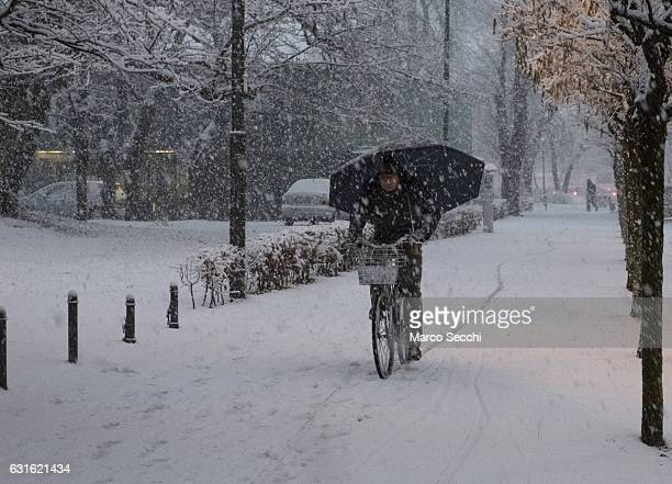 A man rides his bike under heavy snow in the city centre on January 13 2017 in Ljubljana Slovenia Most of Slovenia was covered by heavy snowfalls for...