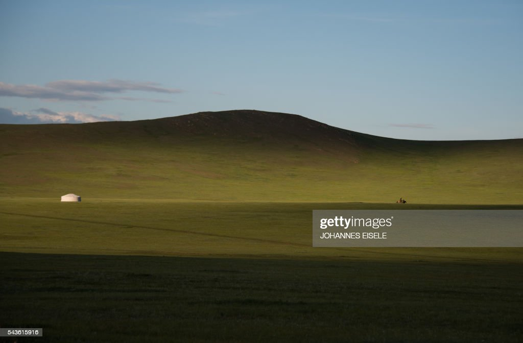 A man rides his horse next to a ger near Zuunmod south of Ulan Bator on June 29, 2016. Mongolians went to the polls across their sprawling, sparsely-populated country on June 29 as it struggles to benefit from its vast natural resources amid disputes over foreign investment and slumping demand from neighbouring China. It took Mongolian nomad Pagvajaviin Shatarbaatar seven days to get to his polling station to vote in in the general election -- accompanied by more than 2,000 sheep, goats and horses. EISELE