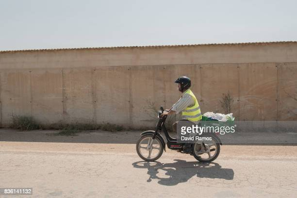 A man rides his scooter across fields of El Campo de Cartagena on July 28 2017 in Los Alcazares Spain El Campo de Cartagena is located along the...