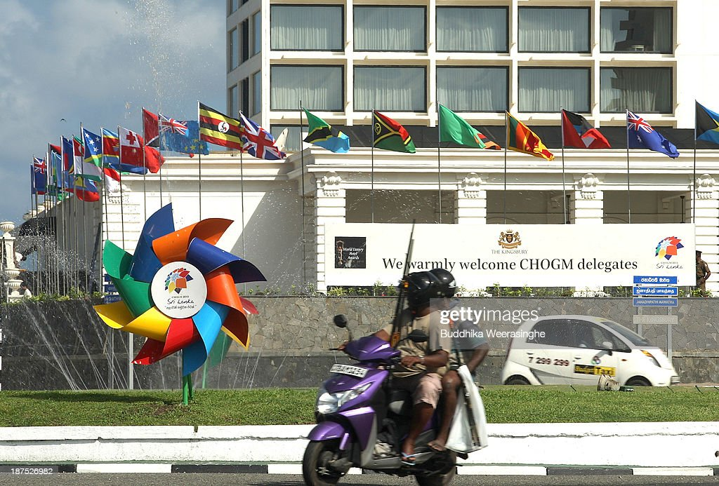 A man rides moterbike front of national flags ahead of the Commonwealth Heads of Government (CHOGM) meetings on November 10, 2013 in Colombo, Sri Lanka. The bi-annual gathering of Commonwealth leaders will take place in the Sri Lankan captial, Columbo, November 15-17. CHOGM will move forward despite some human rights groups are urging leaders to boycott the meetings until Sri Lanka further investigates charges of war crimes. Canadian Prime Minister, Stephen Harper has already confirmed he will not attend.
