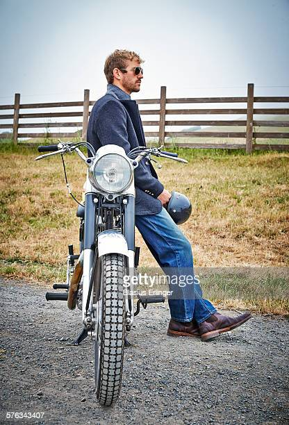 Man rides motorcycle in countryside