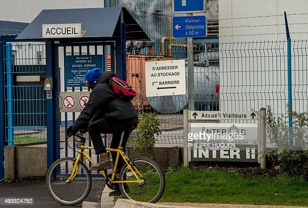 A man rides near a Synthexim and Interor chemical plant regulated by the Seveso directive on October 19 near the 'New Jungle' migrants camp in Calais...