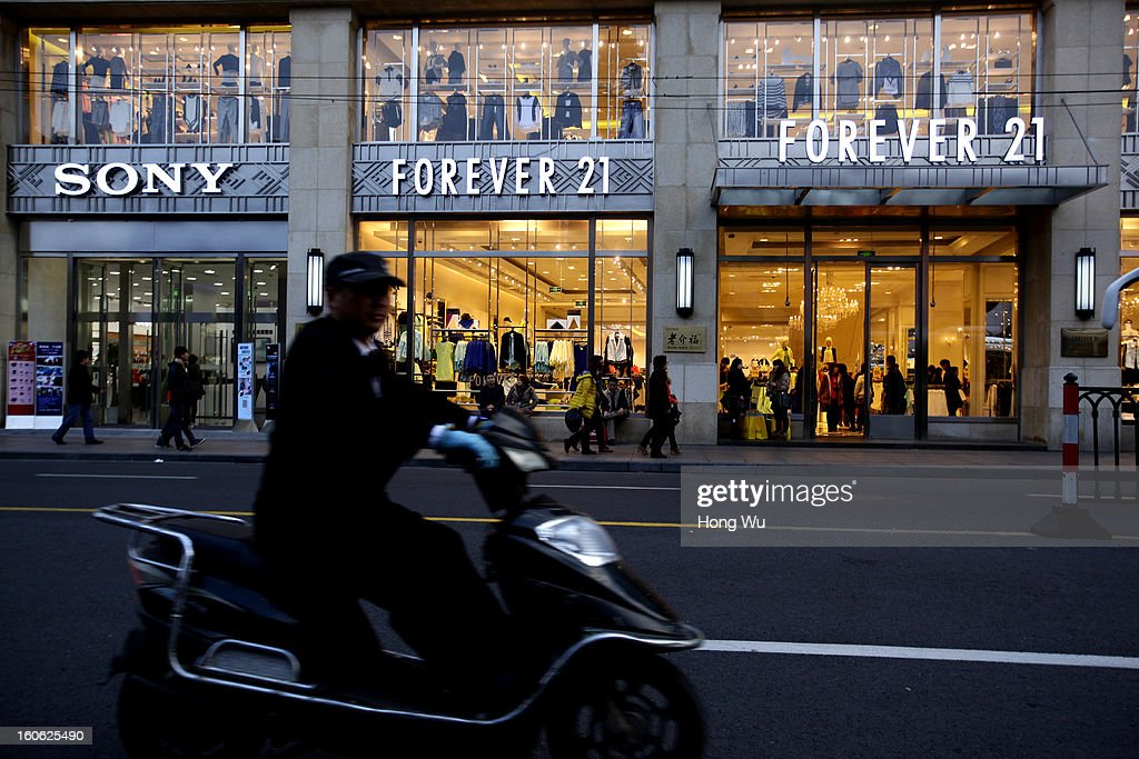 A man rides on motor cycle passing by shops on February 3, 2013 in Shanghai, China.