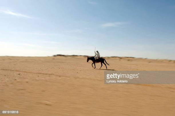 A man rides through the territory along the Chad Darfur border where clashes have been happening between Sudanese government soldiers and NRF rebels...