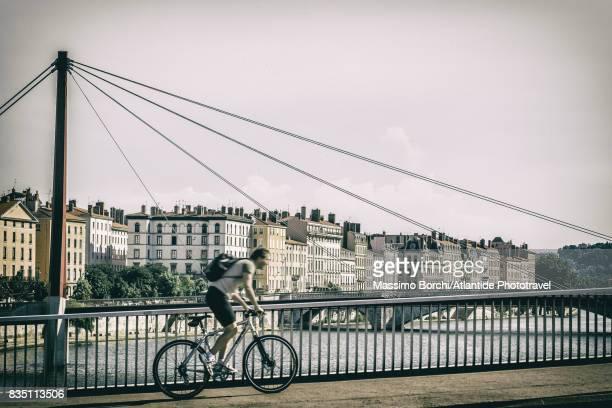 Man riding a bicycle on the Pont Alphonse Juin