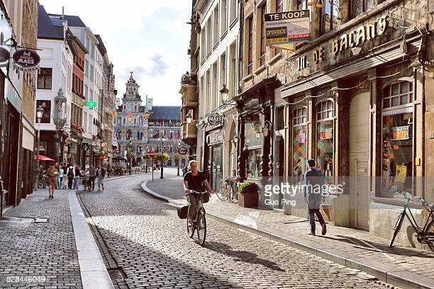 A man riding a bicycle On the street in Antwerp Downtown