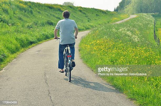 Man riding a bike in spring meadow