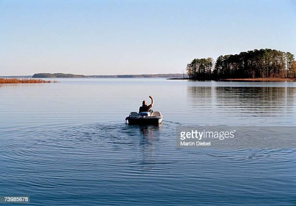 Man riding a pedal boat on a lake
