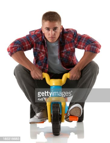 Man riding a tricycle