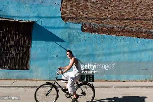 Man riding bicycle in Trinidad, Cuba