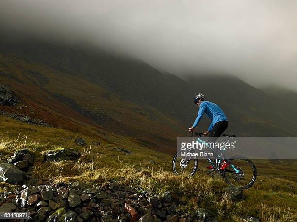 Man riding bike up mountain