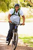 Man riding bike wearing helmet